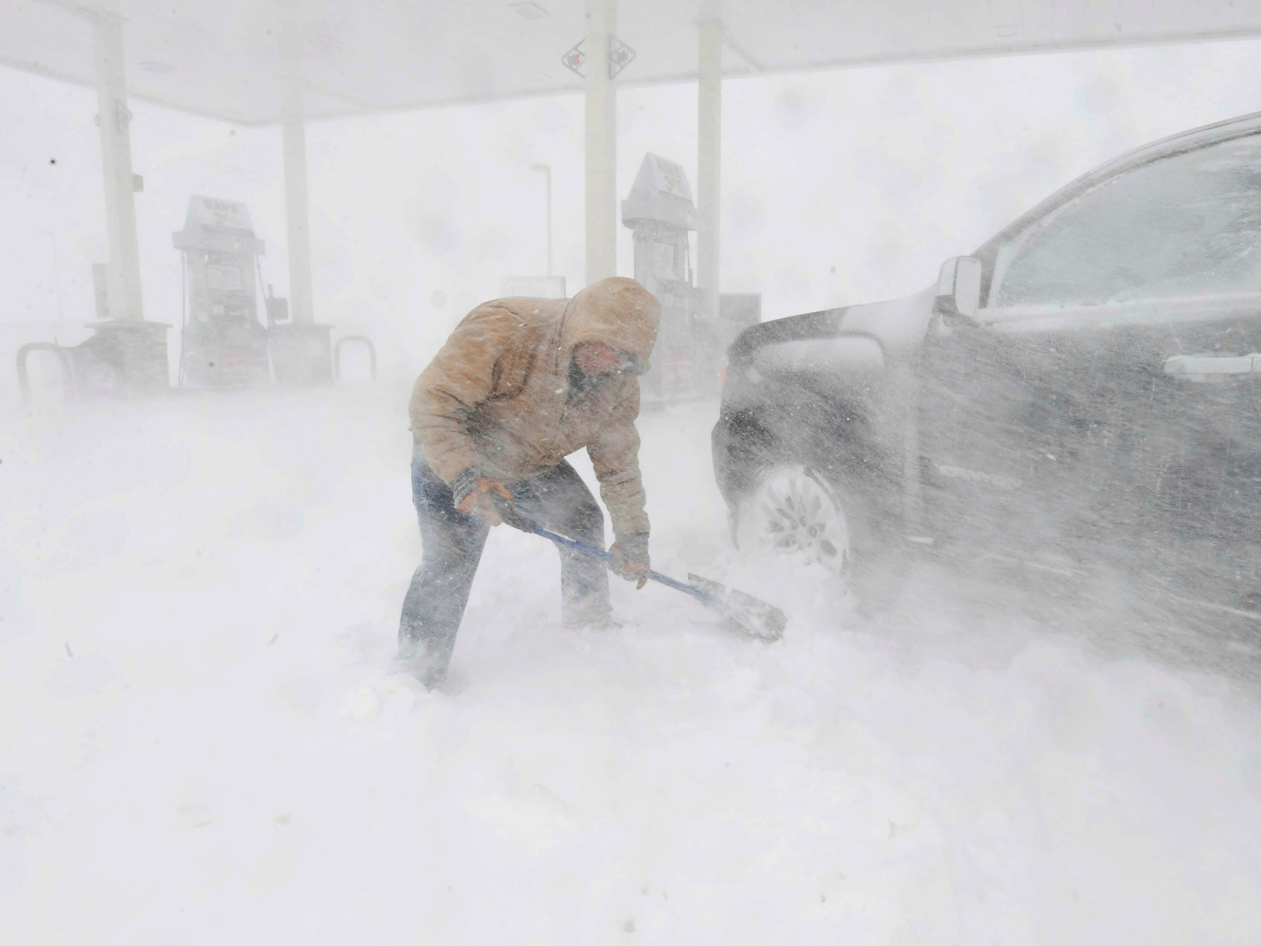 Greg Giannini needed to get gas for his generator, because the lights were flickering at his home and he was afraid he was going to lose power. Even though he has four wheel drive, his car got stuck at the pumps and he was trying to dig out to get home as the blizzard swirled around him. He was stuck near North Gate Blvd. in Colorado Springs, Colorado, on Wednesday, March 13, 2019.