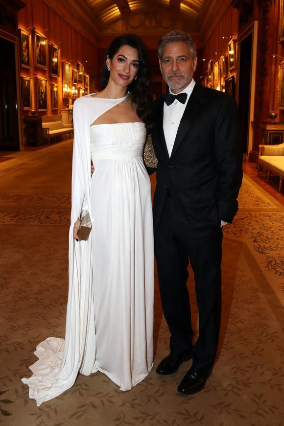 Amal and George Clooney were their chic best at a dinner to celebrate The Prince's Trust, hosted by Prince Charles at Buckingham Palace.