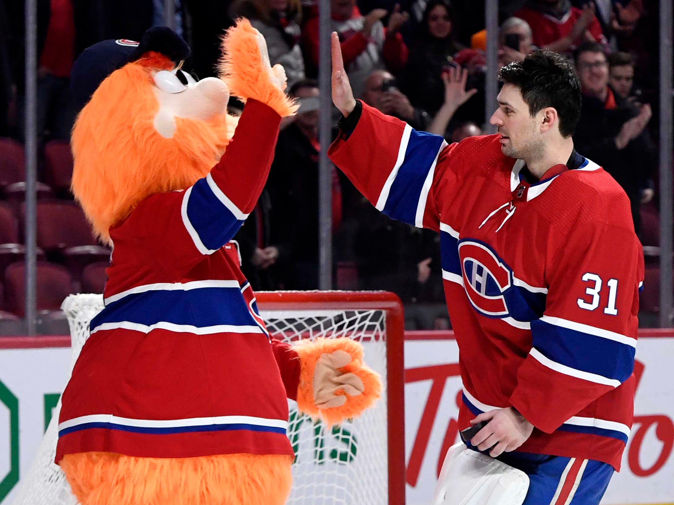 March 12: Montreal Canadiens goalie Carey Price high-fives team mascot Youppi! after becoming the team's winningest goalie with his 315th career victory.