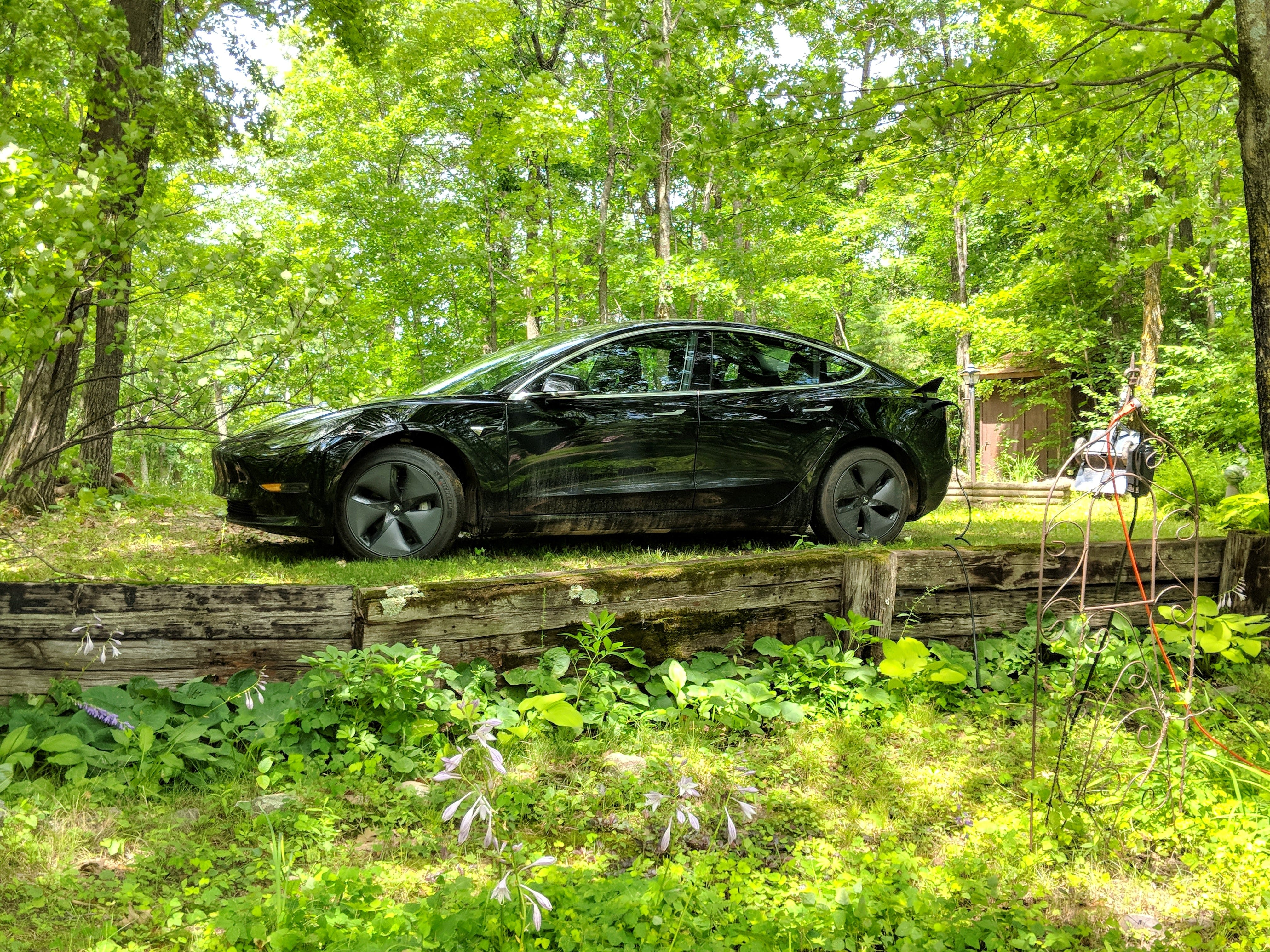 A Model 3 trickle charging in the North Woods of Minnesota.