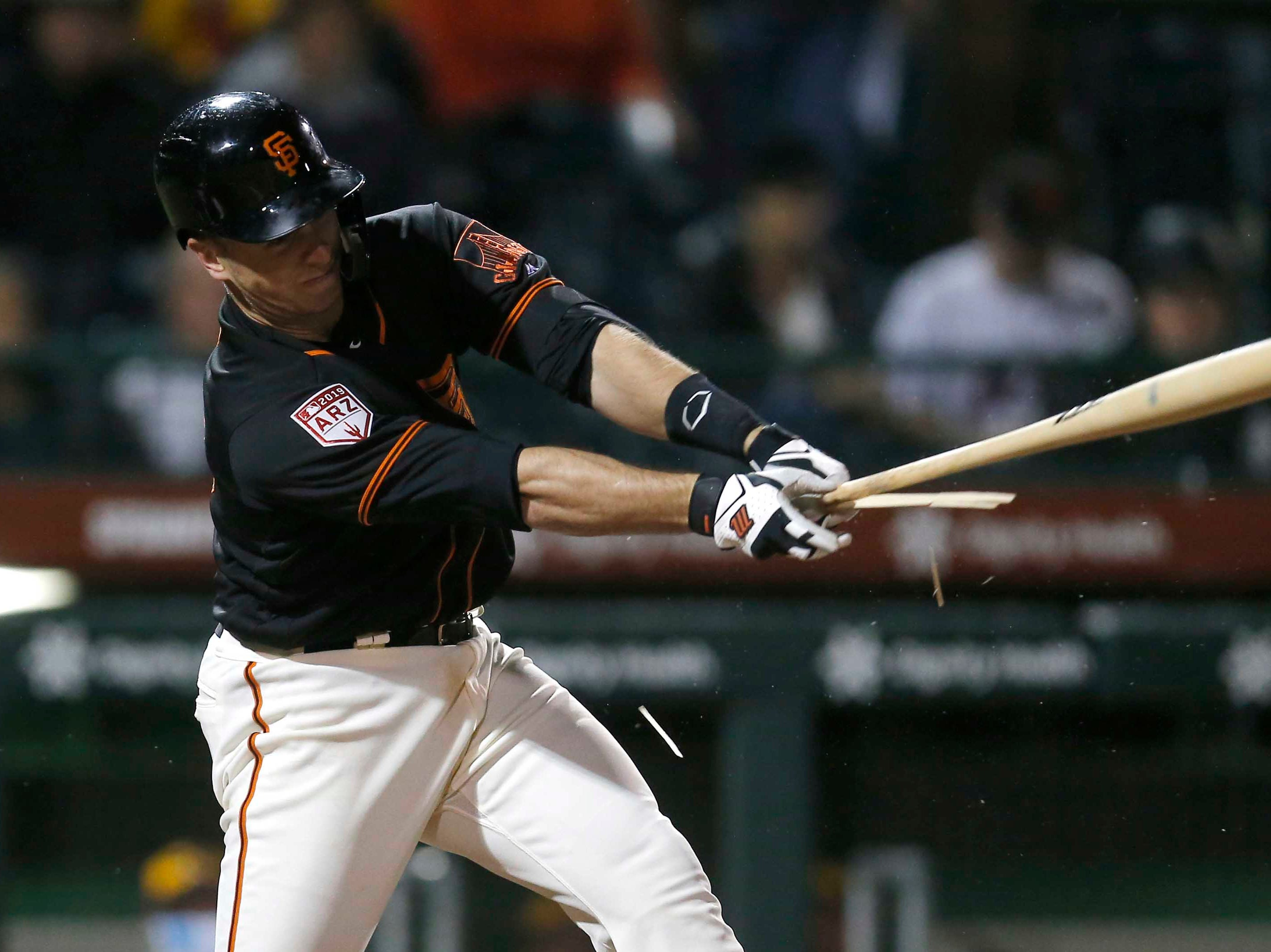 March 12: Giants catcher Buster Posey breaks his bat in the third inning against the Brewers.