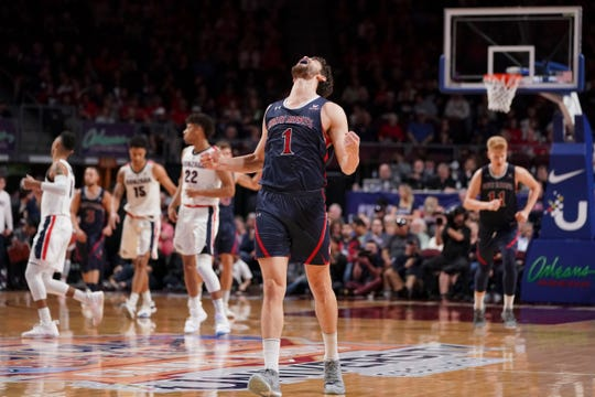 Saint Mary's Gaels center Jordan Hunter (1) celebrates against the Gonzaga Bulldogs after the game in the finals of the WCC Basketball Championships at Orleans Arena.