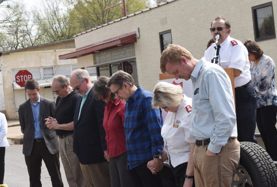Salvation Army Maj. Glenn Riggs (back, right) and clergy members of area churches bless the site where a new 25,000 square foot facility will be built at the corner of 13th and Murray Streets. The shelter will be used to house homeless families and single women.