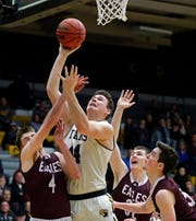 Jack Flynn of UW-Oshkosh goes up for a shot over Ethan Anderson, left, Wyatt Cook, center, and Brendon Manning of UW-La Crosse during a game earlier this season.