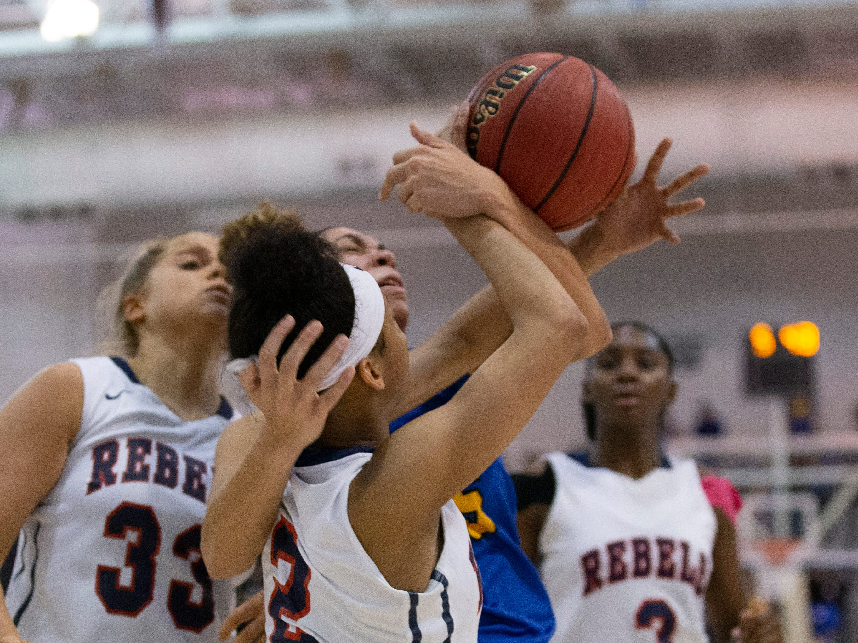 Manchester's Dakota Adams and Saddle River Day's Saniah Caldwell battle for loose ball.  Manchester Girls Basketball vs Saddle River Day in NJSIAA Tournament of Champions Semifinal in Toms River on March 14, 2019.