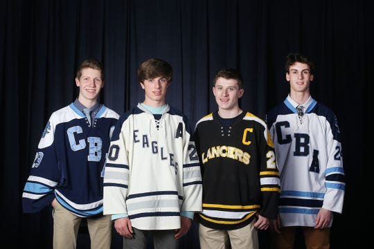 Jake Brown of CBA, Demitri Forand of Middletown South, John Gutt of Saint John Vianney and Kyle Contessa of CBA during the All-Shore ice hockey team photo shoot at the Asbury Park Press in Neptune, NJ Thursday, March 14, 2019.