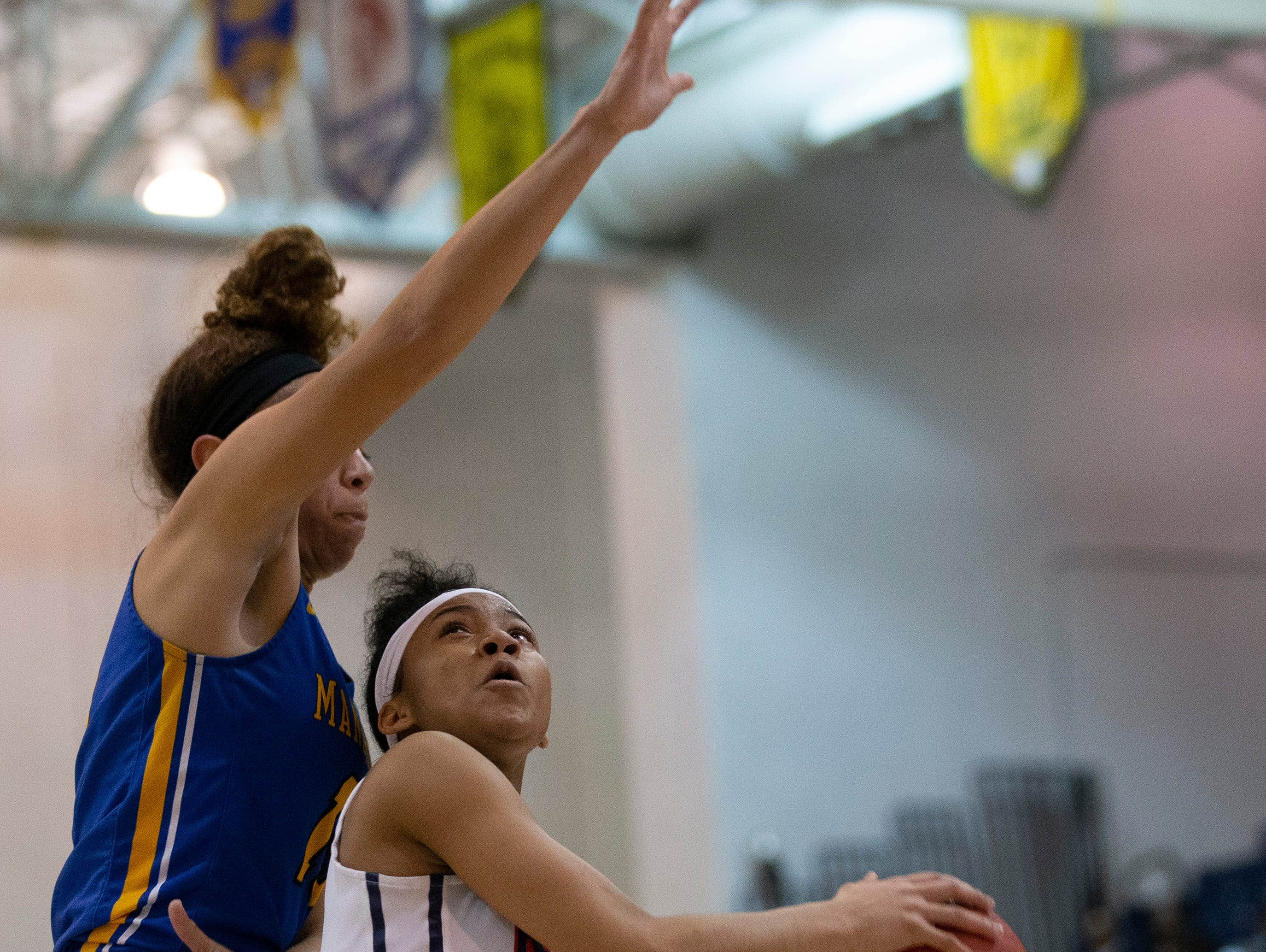 Saddle River Day's Saniah Caldwell tries for a shot as she's covered by Dakota Adams. Manchester Girls Basketball vs Saddle River Day in NJSIAA Tournament of Champions Semifinal in Toms River on March 14, 2019.