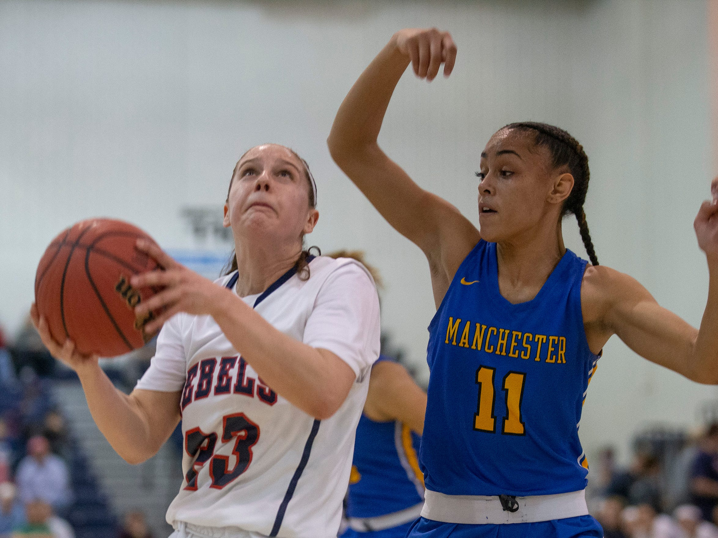 Saddle River Day's Michelle Sidor goes up with a shot as Manchester's Leilani Correa covers her. Manchester Girls Basketball vs Saddle River Day in NJSIAA Tournament of Champions Semifinal in Toms River on March 14, 2019.