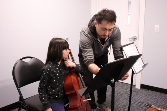 Monmouth Conservatory of Music instructor Leo Soeda with student Emma Birch.