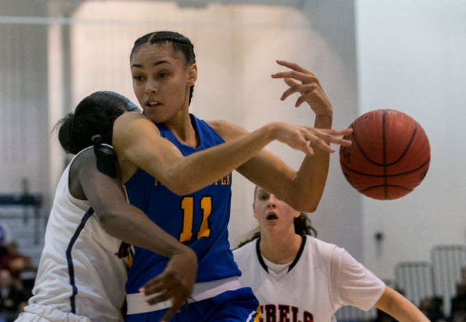 Manchester's Leilani Correa looses ball as she collides with Saddle River's Jaida Patrick. Manchester Girls Basketball vs Saddle River Day in NJSIAA Tournament of Champions Semifinal in Toms River on March 14, 2019.