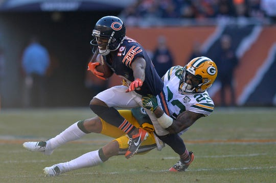 Chicago Bears wide receiver Taylor Gabriel (18) is tackled by Green Bay Packers cornerback Jaire Alexander (23) at Soldier Field.