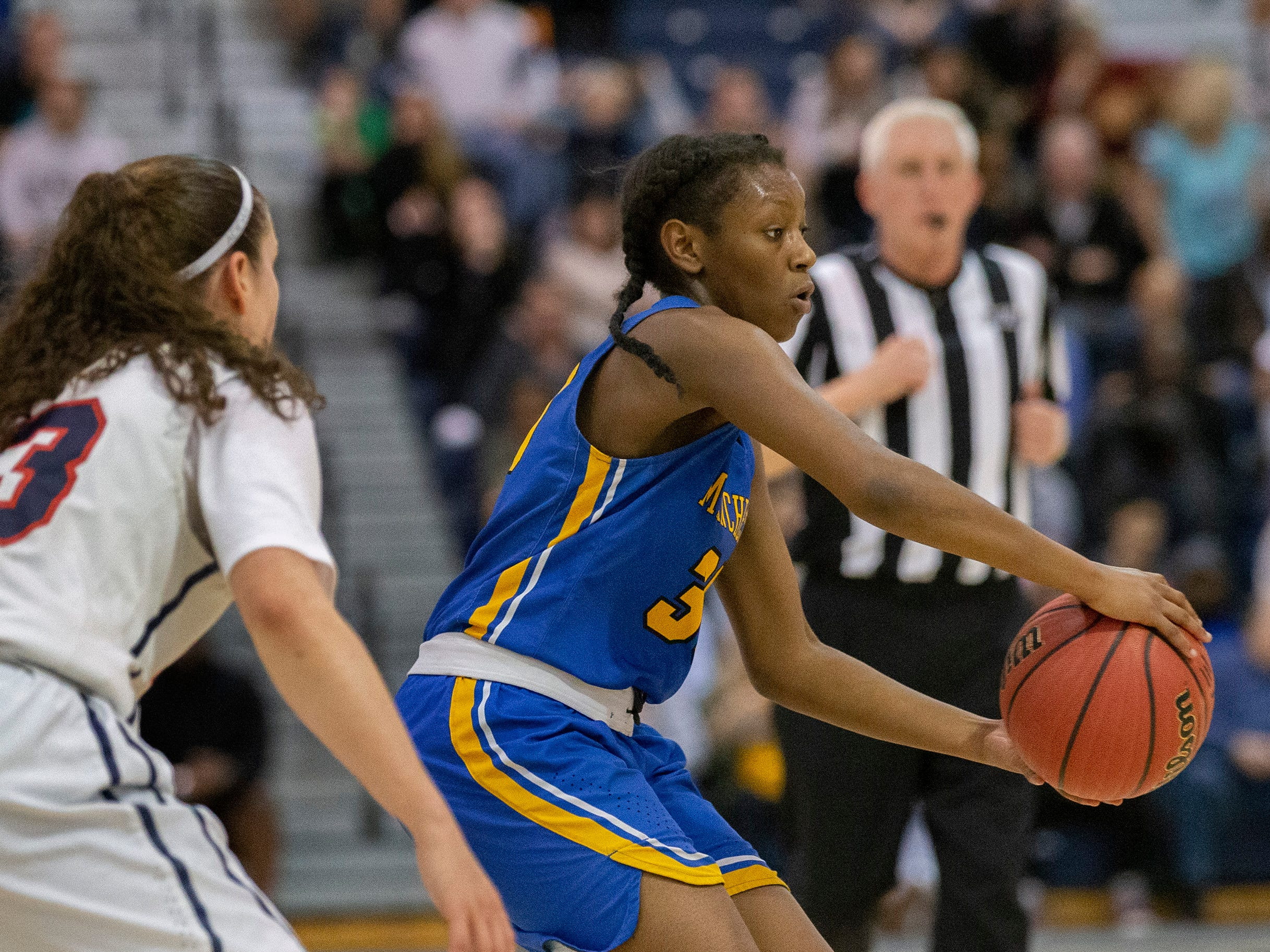 Manchester's Serenity Anderson looks to pass in with Michelle Sidor of Saddle River Day defending. Manchester Girls Basketball vs Saddle River Day in NJSIAA Tournament of Champions Semifinal in Toms River on March 14, 2019.
