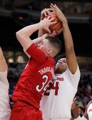 Rutgers guard/forward Ron Harper Jr., right, steals the ball from Nebraska guard Thorir Thorbjarnarson