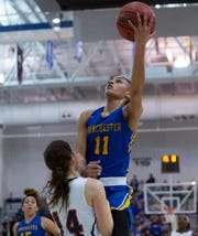 Manchester's Leilani Correa goes up with shot against Saddle River Day's Jordan Janowski. Manchester Girls Basketball vs Saddle River Day in NJSIAA Tournament of Champions Semifinal in Toms River on March 14, 2019.