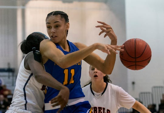 Manchester's Leilani Correa looses ball as she collides with Saddle River Day's Jaida Patrick. Manchester Girls Basketball vs Saddle River Day in NJSIAA Tournament of Champions Semifinal in Toms River on March 14, 2019.