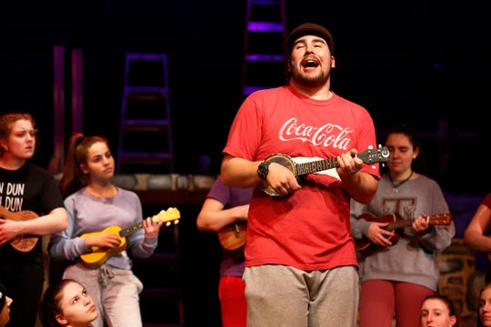 """Jacob Gerbman is shown in his role as """"Uncle Fester"""" during rehearsal for Rumson-Fair Haven High School's spring play """"The Addams Family."""""""