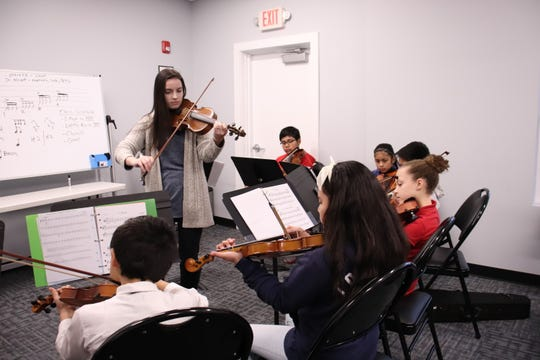 Violin instructor Laura Petillo works with Monmouth Conservatory of Music students.