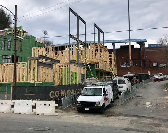 Bauhaus South Slope Townhomes are being built in front of McCormick Field, the home of the Asheville Tourists. The project is being done by a private developer on land not owned by the Tourists or city of Asheville.
