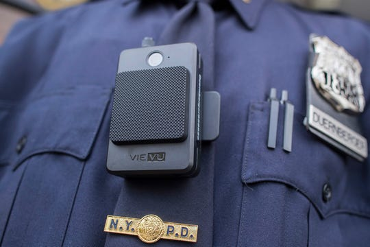 "FILE - In this April 27, 2017 file photo, a police officer wears a newly-issued body camera outside in New York. In 2018, the New York City Police Department, the nation's largest, stopped releasing body camera video after a police union successfully argued in court that they were confidential personnel records. But the department vowed in February 2019 to continue releasing video of officer-involved shootings after an appeals court ruled that the union's argument ""would defeat the purpose of the body-worn-camera program."" (AP Photo/Mary Altaffer)"