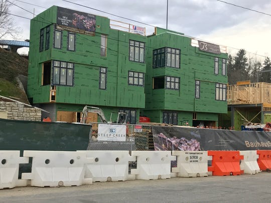 The Bauhaus South Slope Townhomes are being built on property in front of McCormick Field, home of the Asheville Tourists. The project is going up on private property not owned by the Tourists or the city of Asheville.