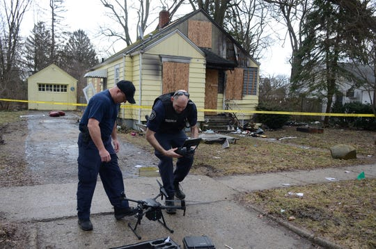 Officers Todd Rathjen, left, and Andrew Olsen brought a drone to the scene of the fire to photograph the damage.