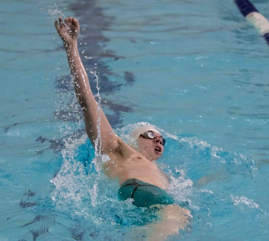 Marshall's Tommy Huyge competes in the 200 Yard IM at the Southwestern & Central Swimming and Diving Finals on Saturday.