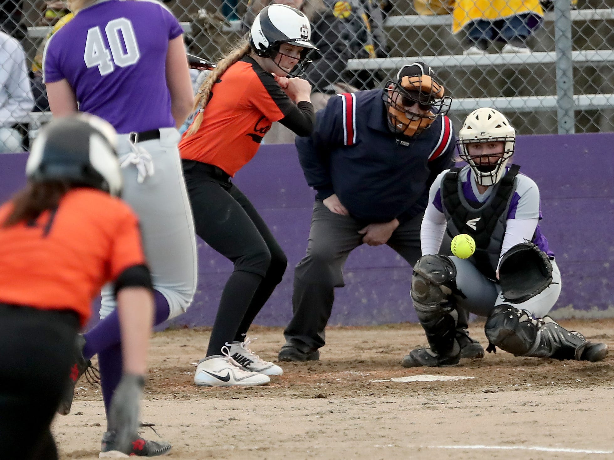 North Kitsap catcher Lamara Villiard makes a catch against Central Kitsap Softball in Poulsbo on Wednesday, March 13, 2019.