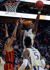 Washington's Nahziah Carter shoots over Southern California's Bennie Boatwright during the first half of an NCAA college basketball game in the quarterfinal round of the Pac-12 men's tournament Thursday, March 14, 2019, in Las Vegas.