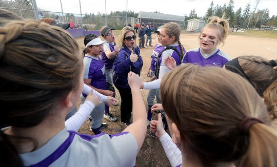 North Kitsap coach Jamie Smaaladen (center) joins her team in a cheer prior to the start of their game against Central Kitsap in Poulsbo on March 13. The Vikings qualified for the Class 2A state tournament in 2018.