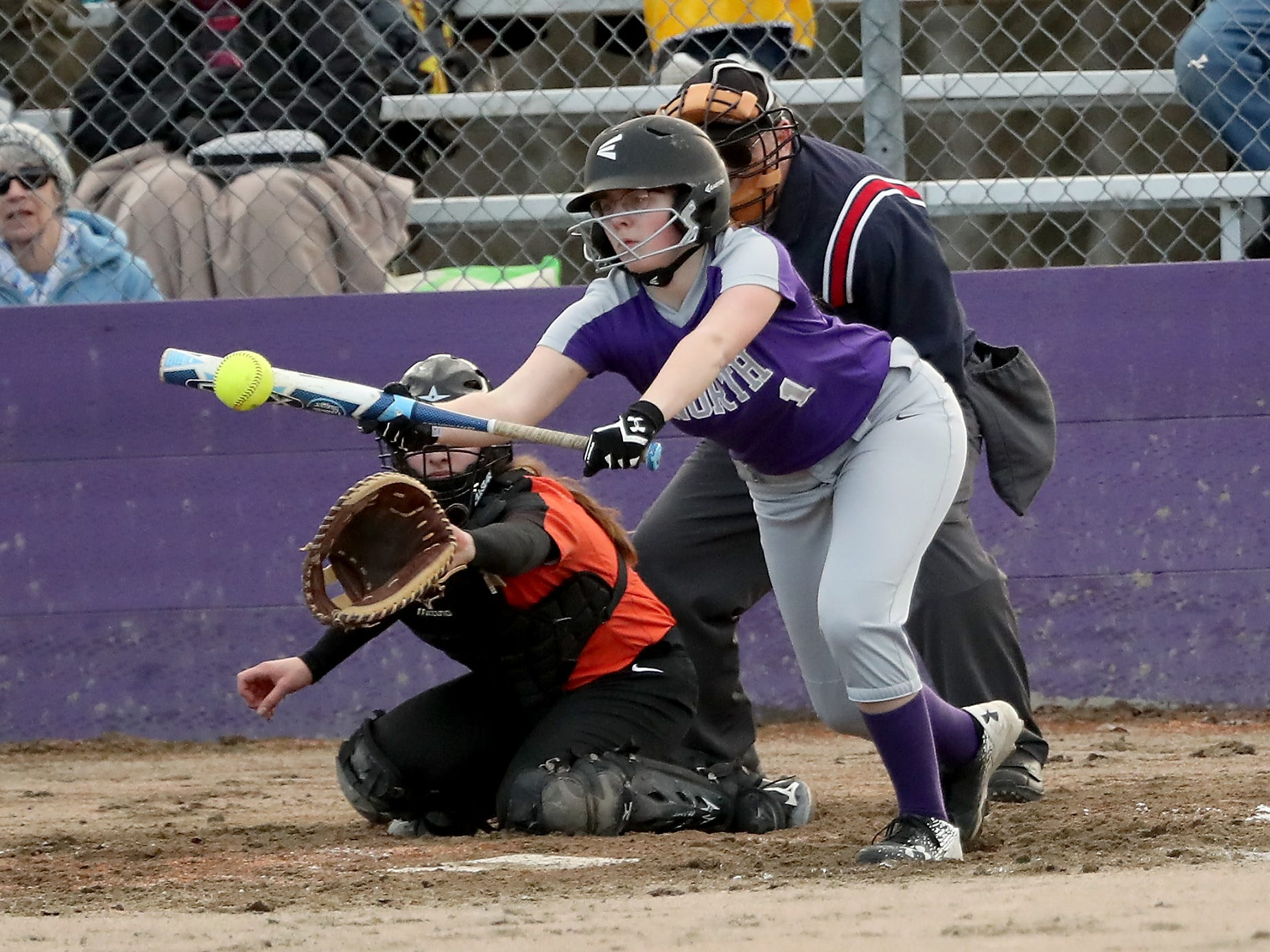 North Kitsap's Samantha Burgh (1) connects with a bunt against Central Kitsap Softball in Poulsbo on Wednesday, March 13, 2019.