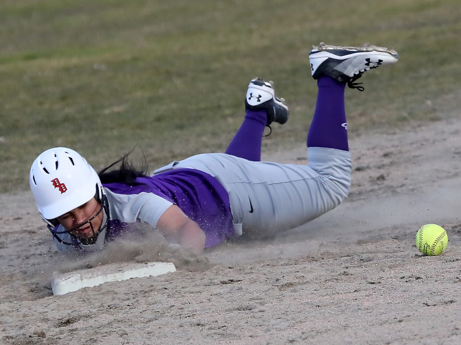 North Kitsap's Alicia Goetz slides into second in Poulsbo on Wednesday, March 13, 2019.