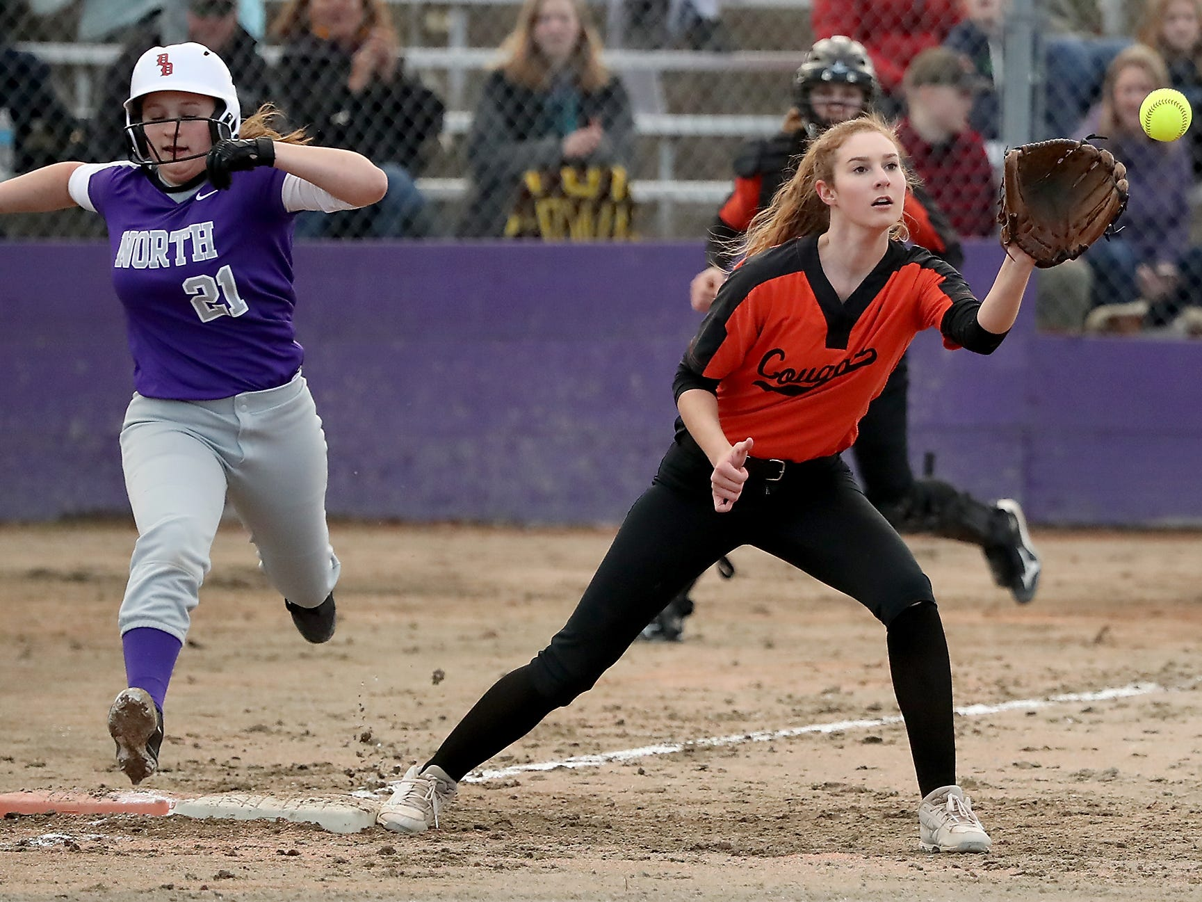 Central Kitsap's Annika Freund (right) makes the catch in time and North Kitsap's Iyreland Lawson is out at first during their game in Poulsbo on Wednesday, March 13, 2019.