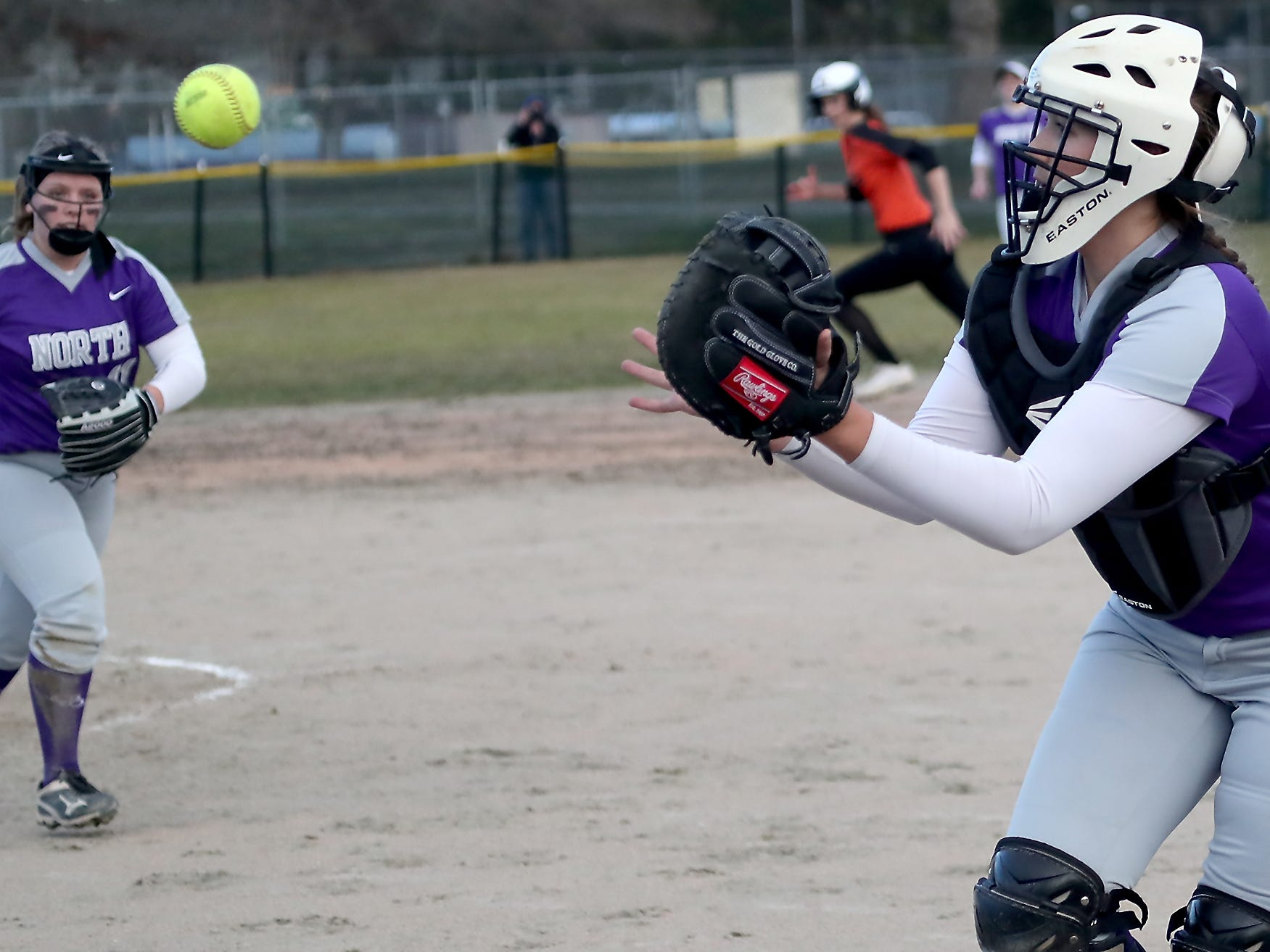 North Kitsap catcher Lamara Villiard makes a catch against Central Kitsap in Poulsbo on Wednesday, March 13, 2019.