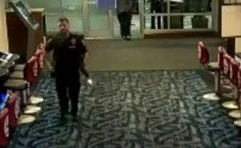 Security footage shows Bainbridge Island officer's rifle inadvertently discharging as he rushes to the scene of a 'help' call in April 2018.