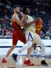 Washington's Noah Dickerson, right, drives into Southern California's Nick Rakocevic, left, during the first half of an NCAA college basketball game in the quarterfinal round of the Pac-12 men's tournament Thursday, March 14, 2019, in Las Vegas.