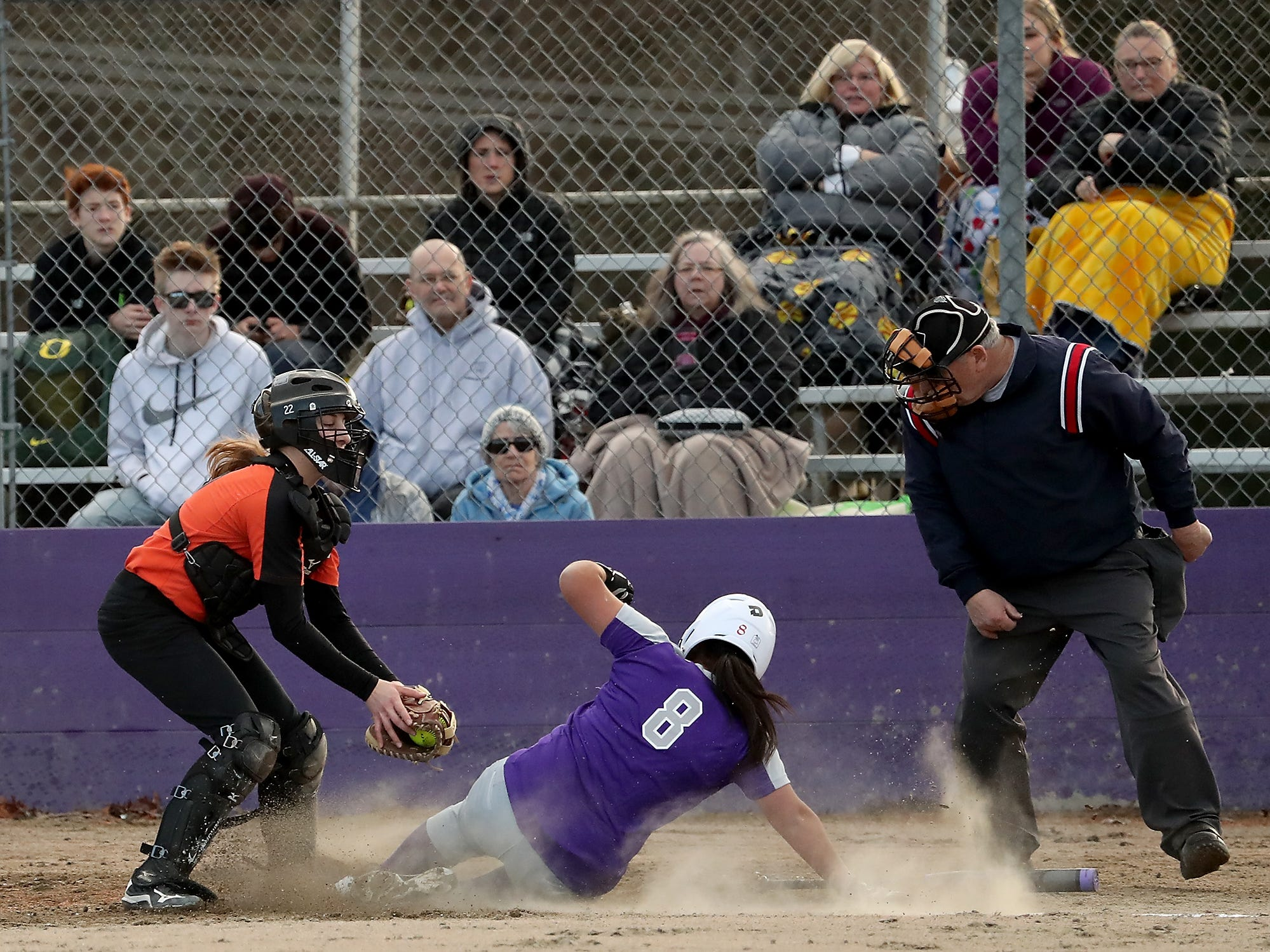 North Kitsap's Alicia Goetz is out on a slide into home against Central Kitsap in Poulsbo on Wednesday, March 13, 2019.