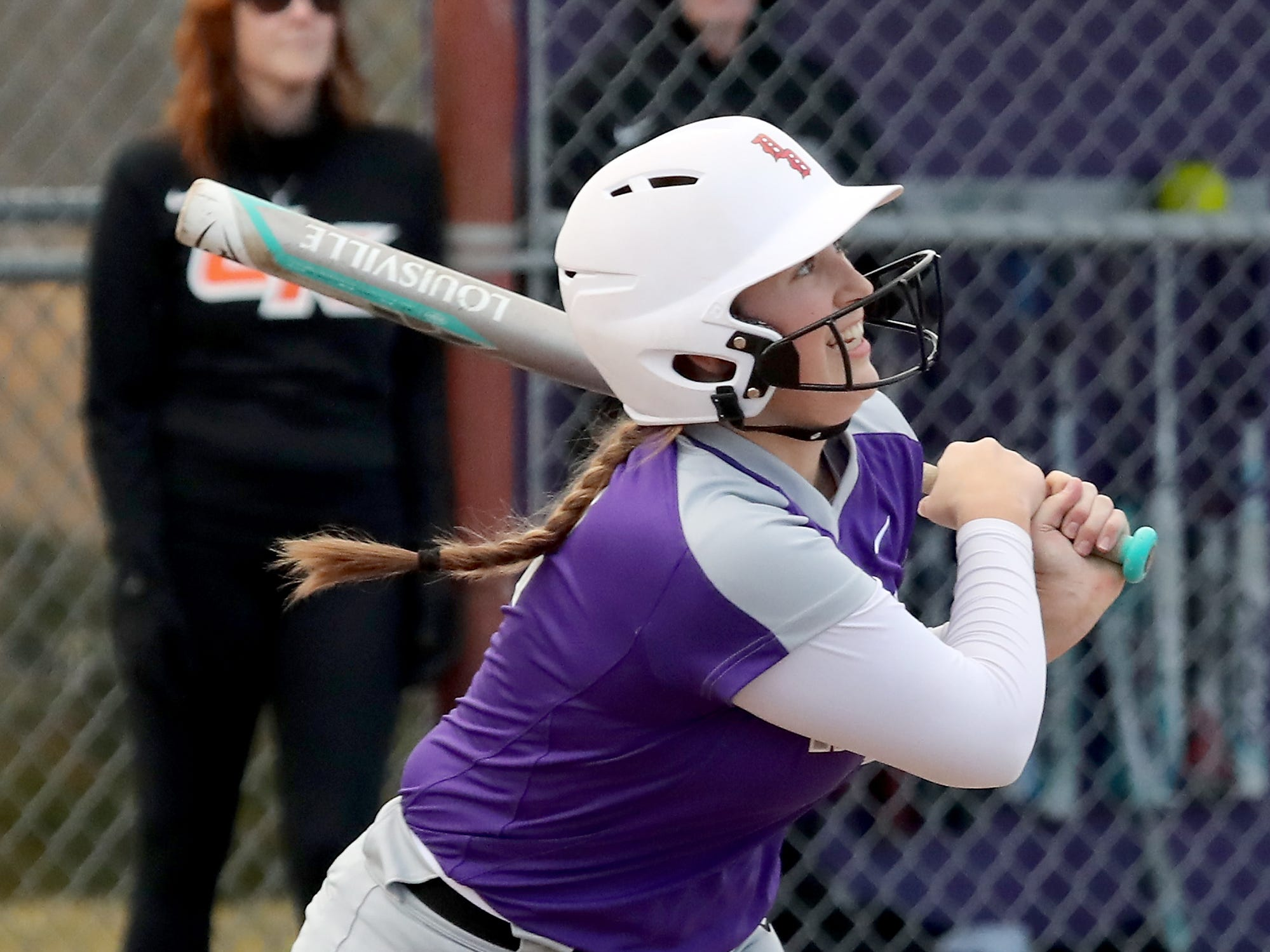 North Kitsap's Lamara Villiard smiles after connecting with a pitch against Central Kitsap Softball in Poulsbo on Wednesday, March 13, 2019.
