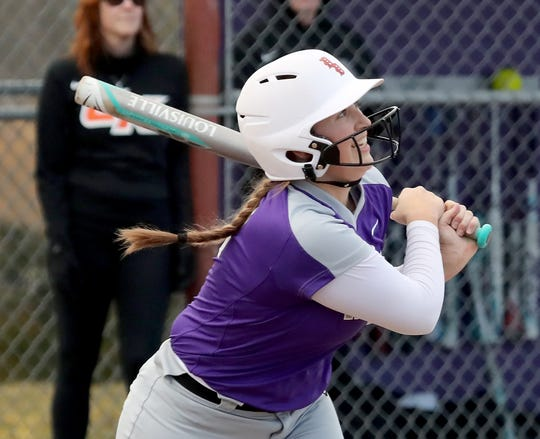 North Kitsap's Lamara Villiard smiles after connecting with a pitch against Central Kitsap in Poulsbo on Wednesday, March 13, 2019.
