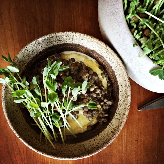 Add a little raw green to any meal. Here, lentils, polenta and warm cream.
