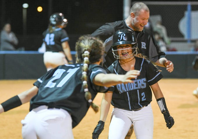 Cali Madonna welcomes Jenna Garza of Rockledge back to the bench after she scored during Wednesday's game against Astronaut.