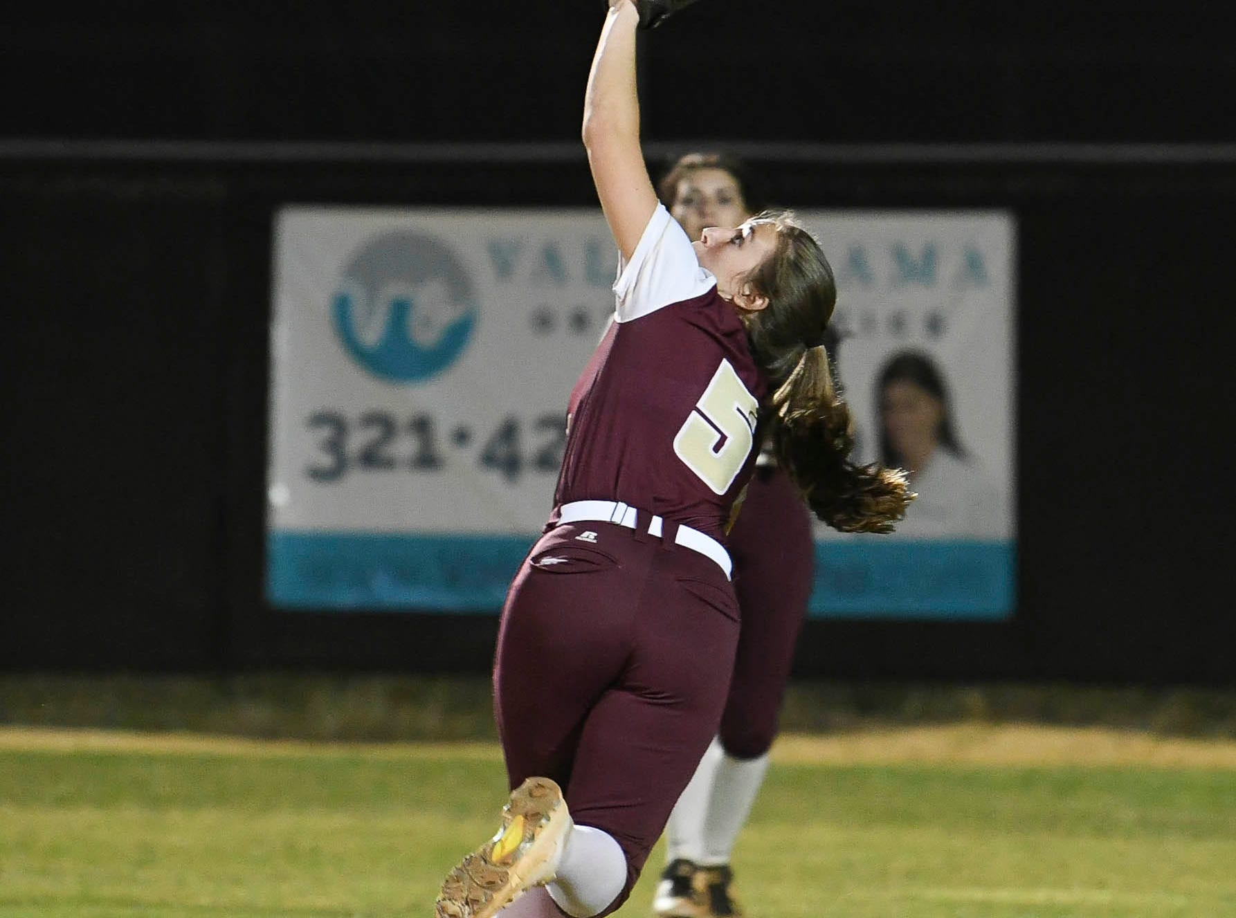 R. Rhodes of Astronaut tracks down a fly ball in the outfield during Wednesday's game against Rockledge.