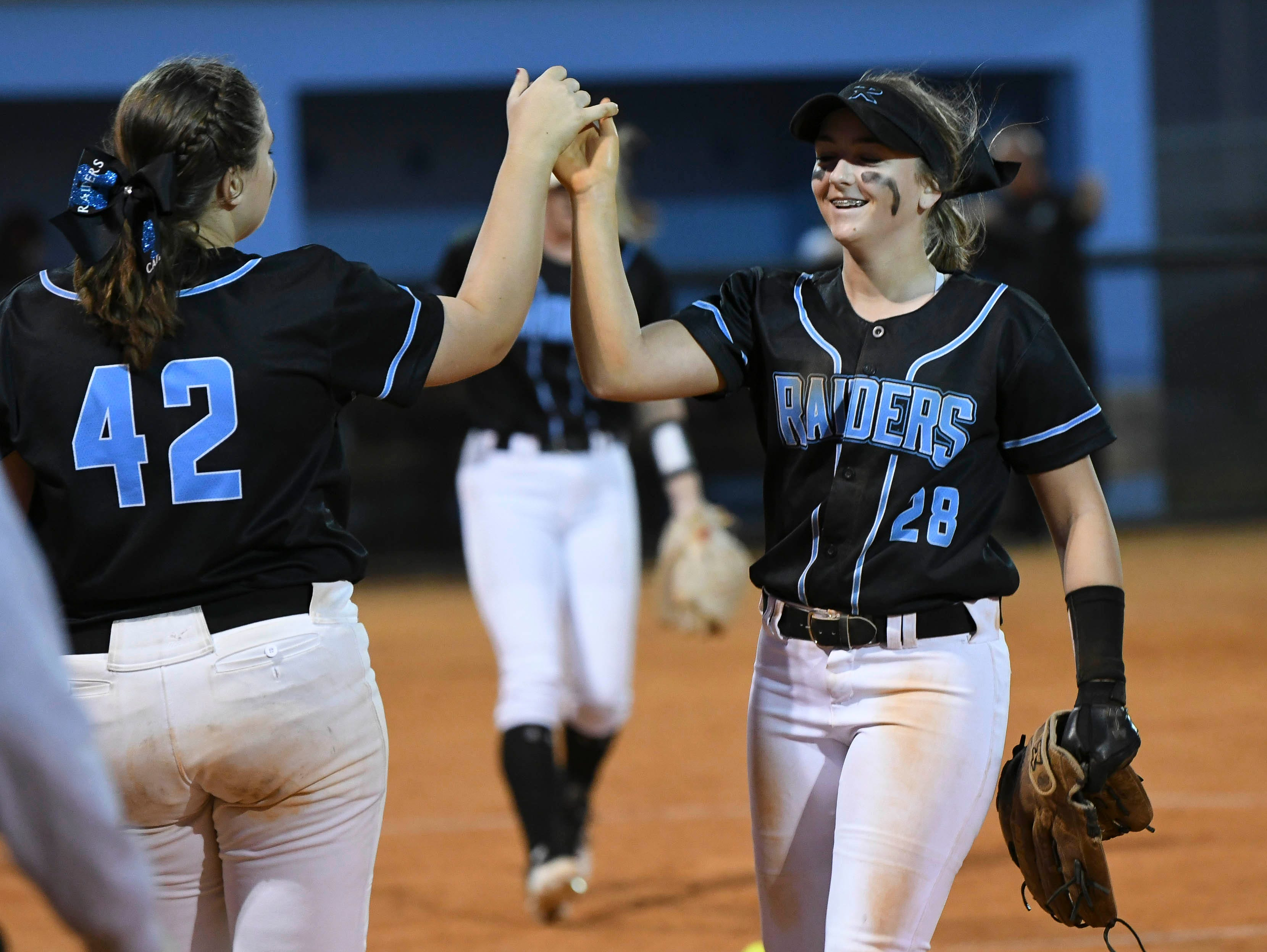 Caitlyn Tuttle highs-fives teammate Emily Thomas during Wednesday's game against aA