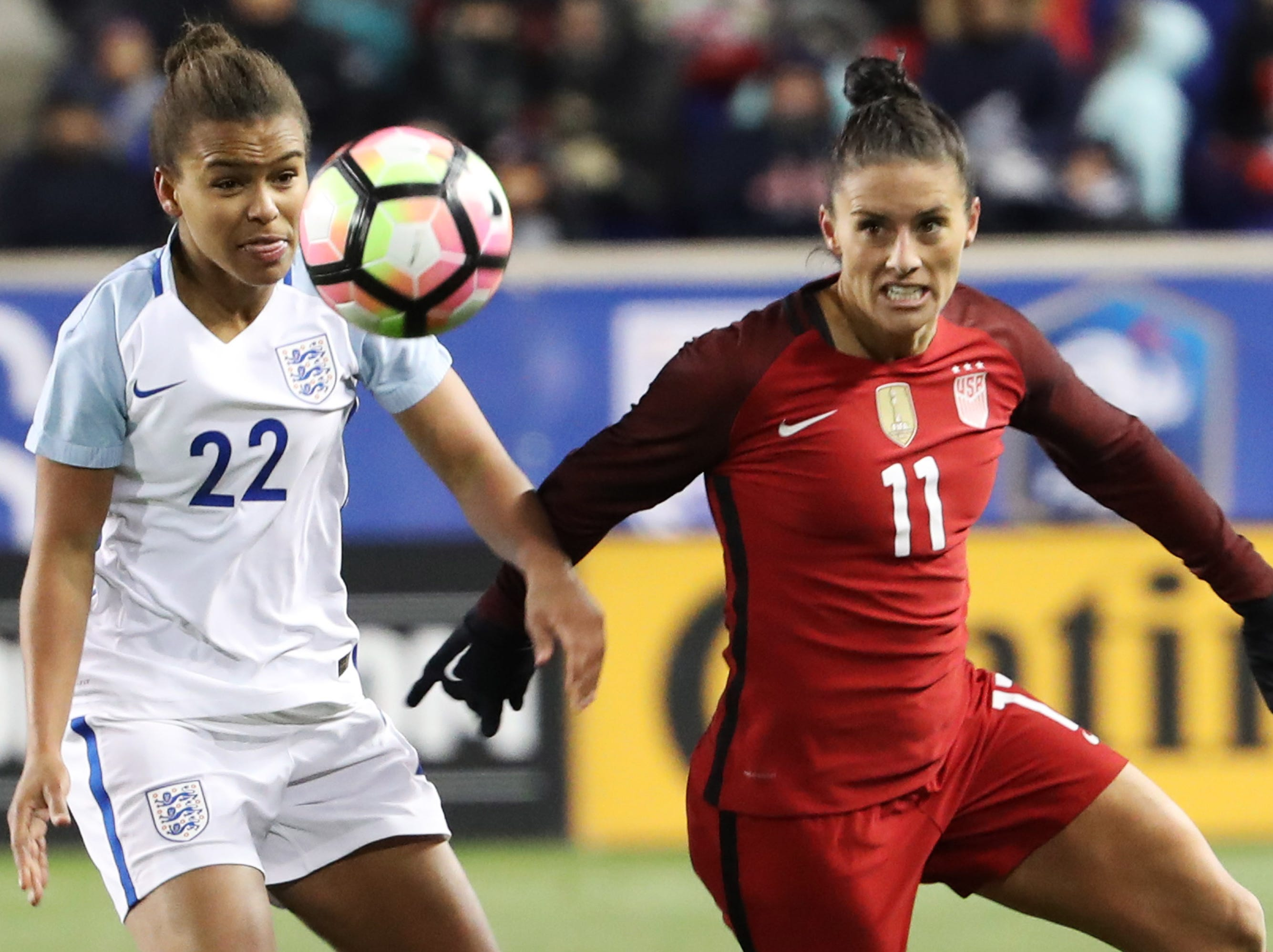 England's Nikita Parris (L) and United States' Ali Krieger (R) eye the ball as the United States and England women's national teams play in the SheBelieves Cup in Harrison, NJ, on March 4, 2017.  / AFP PHOTO / DOMINICK REUTER        (Photo credit should read DOMINICK REUTER/AFP/Getty Images)