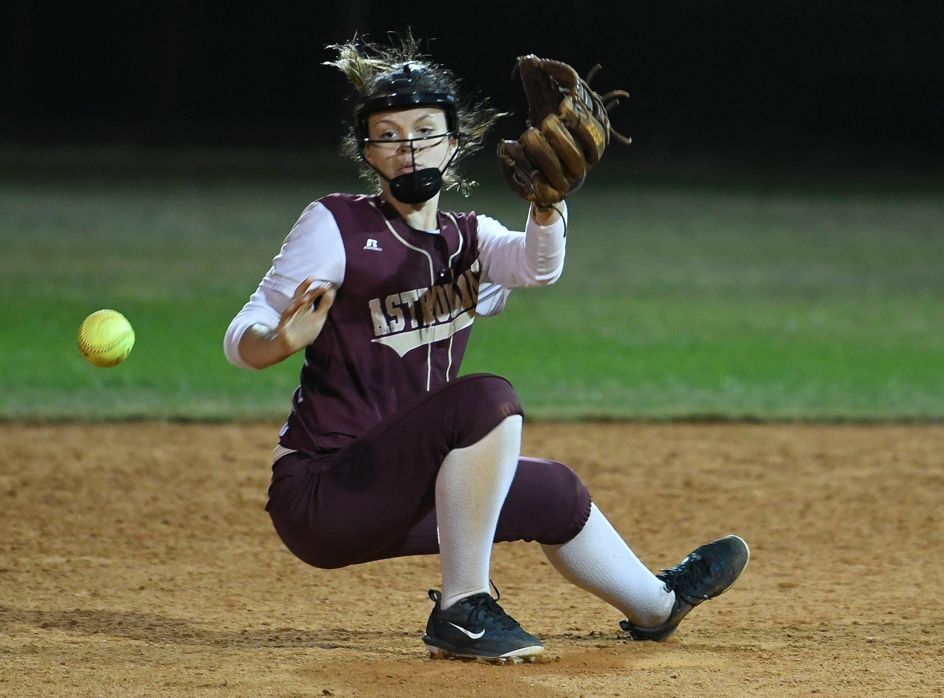 J. Lenders of Astronaut loses her footing trying to retrieve a grounder during Wednesday's game against Rockledge