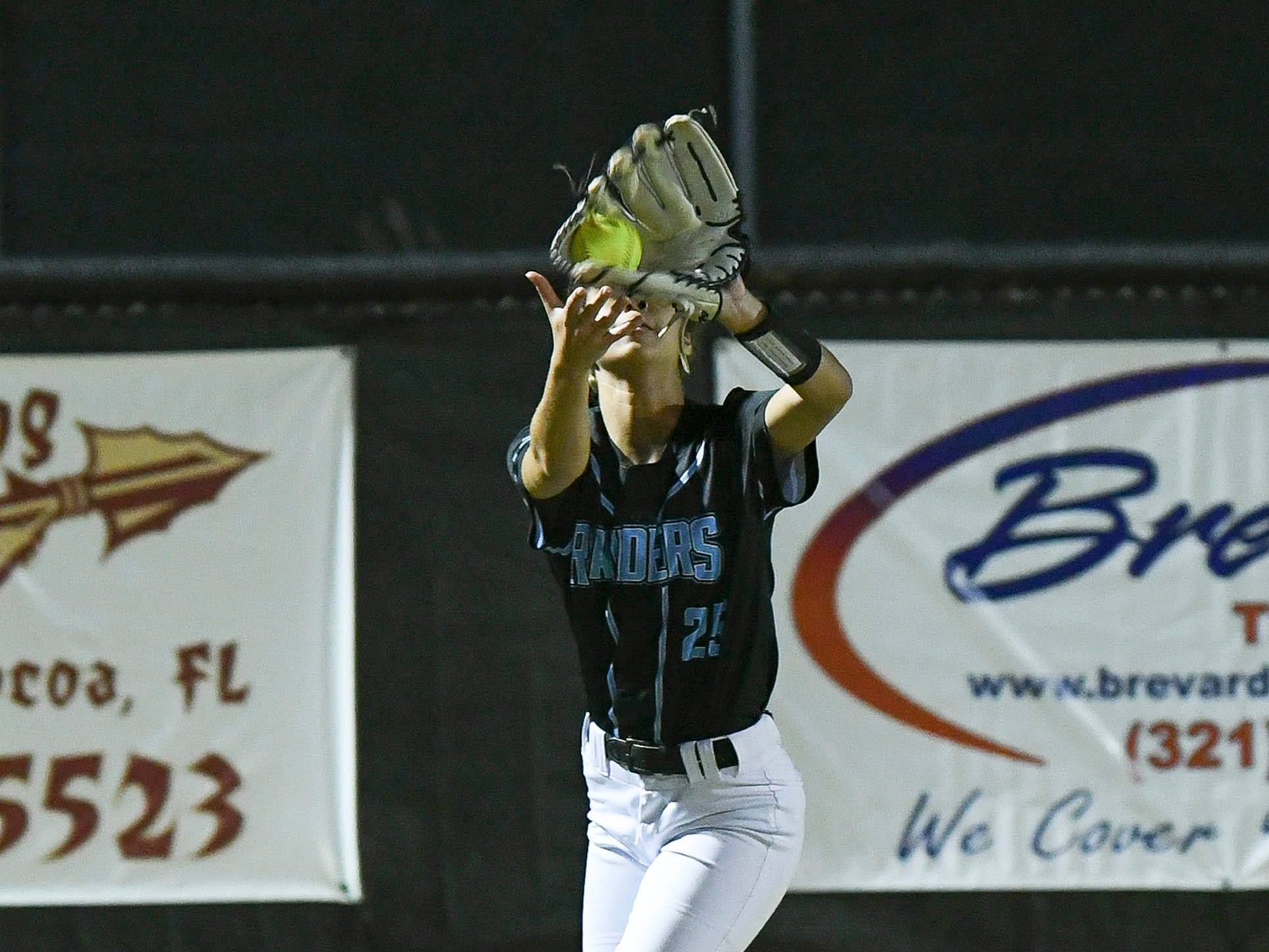 Autumn Charvet of Rockledge tracks down a fly ball during Wednesday's game in Rockledge
