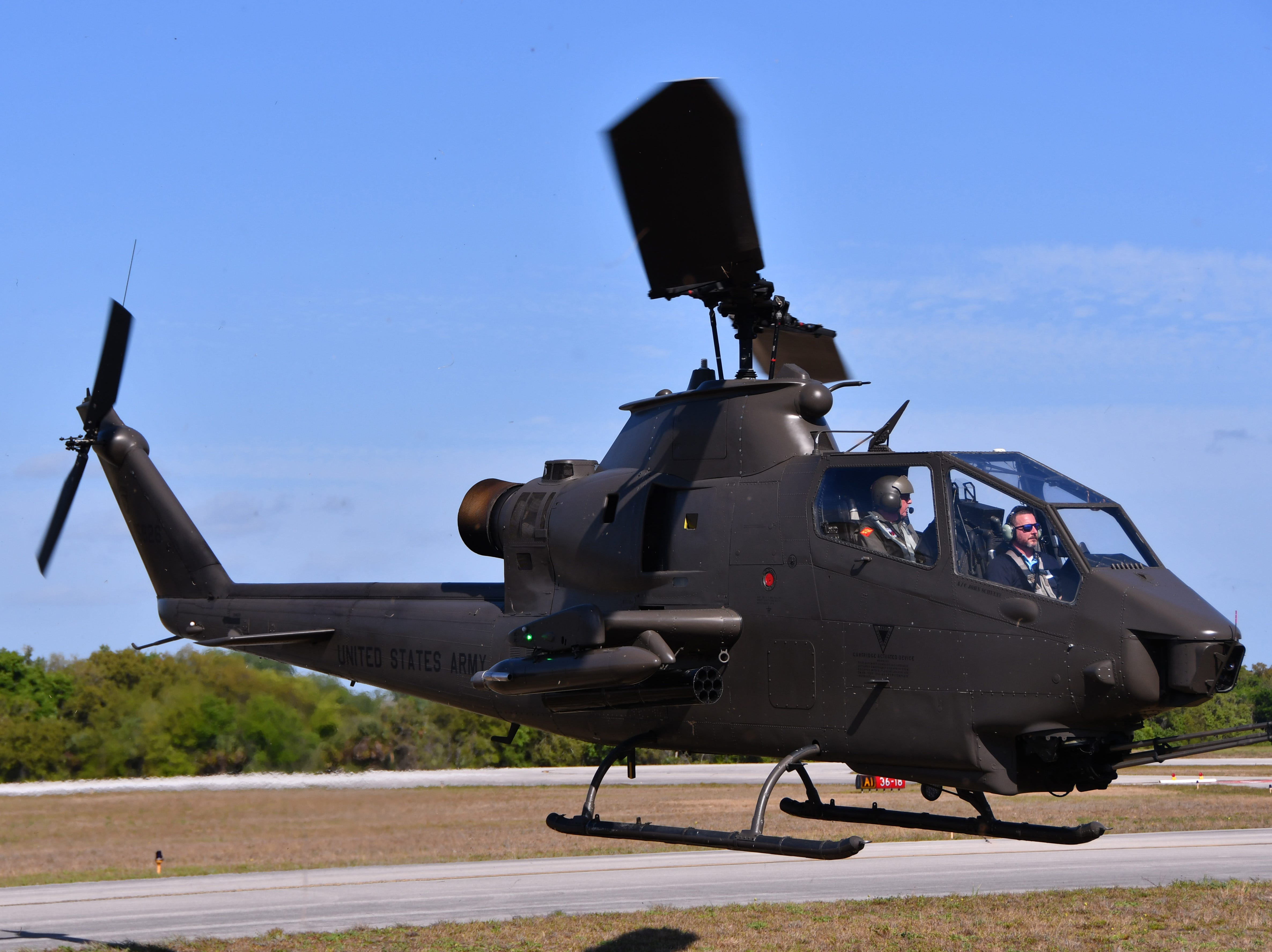 An AH-1 Cobra helicopter comes in for a landing. The 2019 Space Coast Warbird Air Show held their media day Thursday, promoting the Air Show that runs Friday, Saturday and Sunday at Space Coast Regional Airport in Titusville, with a Friday afternoon and evening show with fireworks, and shows Saturday and Sunday afternoon.