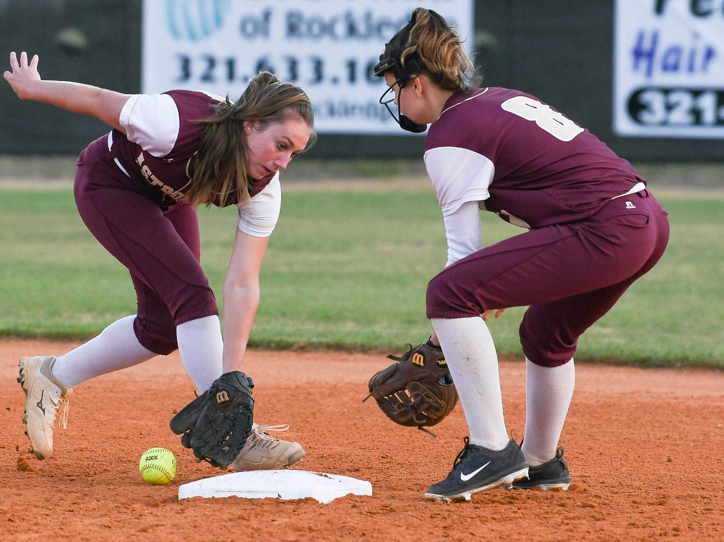 R. Rhodes and J. Lenders of Astronaut both try to retrieve a grounder during Wednesday's game against Rockledge.