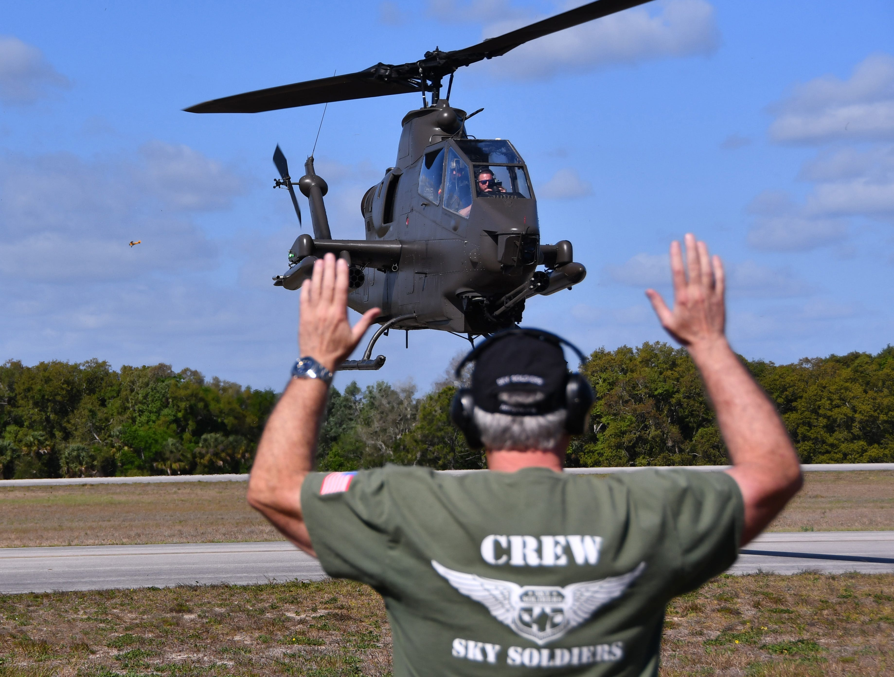 An AH-1 Cobra Helicopter is guided in for landing. The 2019 Space Coast Warbird Air Show held their media day Thursday, promoting the Air Show that runs Friday, Saturday and Sunday at Space Coast Regional Airport in Titusville, with a Friday afternoon and evening show with fireworks, and shows Saturday and Sunday afternoon.