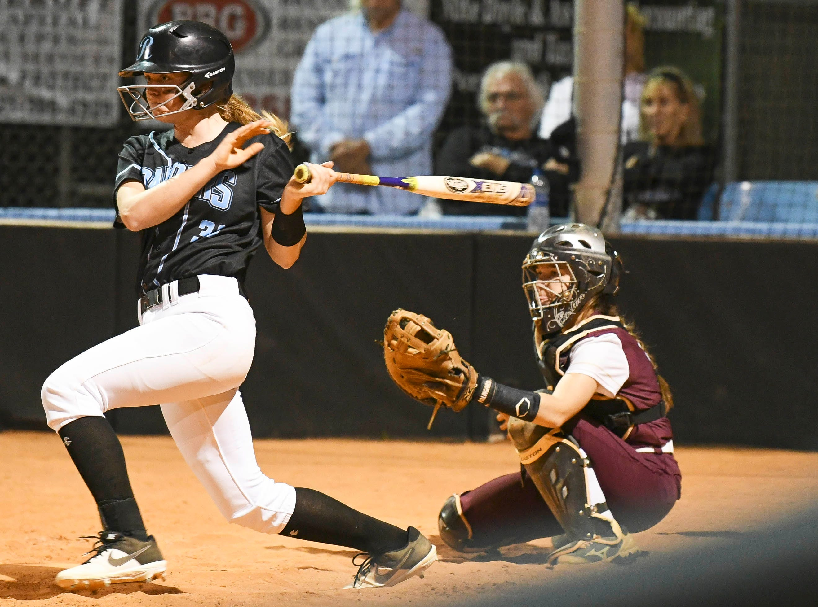 Haley Day of Rockledge puts the ball in play during Wednesday's game in Rockledge