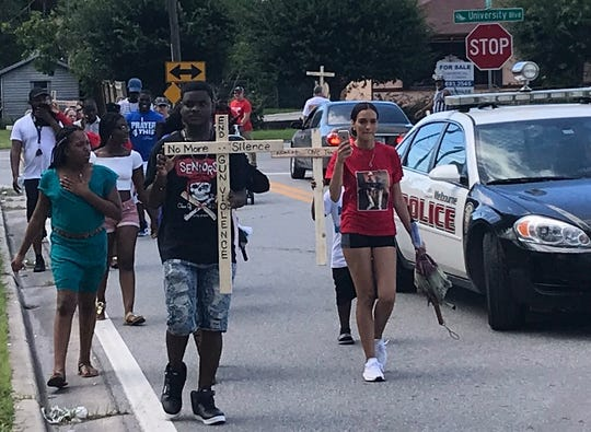 A peace rally held last August along University Boulevard as residents called for an end to shooting violence.